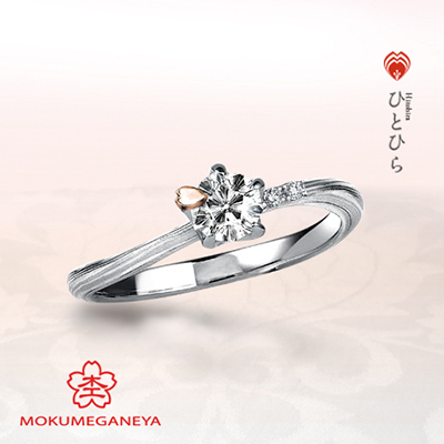 ピンク色の桜の花びらが「さくらダイヤ」に舞い降りる